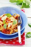 Spaghetti with calamary tomatoes and basil Stock Photography