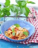 Spaghetti with calamary tomatoes and basil Royalty Free Stock Image