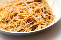 Spaghetti carbonara. A creamy pasta sauce with bacon and parmesan over whole wheat spaghetti noodles Royalty Free Stock Photo