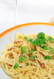 Spaghetti carbonara. Closeup view of spaghetti carbonara on table Royalty Free Stock Photos