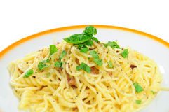 Spaghetti carbonara. Closeup view of spaghetti carbonara in plate, isolated Stock Image