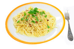 Spaghetti carbonara. Closeup view of spaghetti carbonara in plate, isolated Stock Images