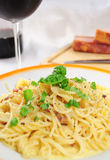 Spaghetti carbonara. Closeup view of spaghetti carbonara on table Royalty Free Stock Photo
