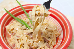 Spaghetti Carbonara. Fork of Spaghetti Carbonara on plate Royalty Free Stock Photography