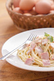 Spaghetti carbonara. On a white plate with ham Royalty Free Stock Photography