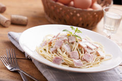 Spaghetti carbonara. On a white plate with ham stock photos