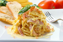 Spaghetti Carbonara. Spagetti carbonara on a white plate Stock Image