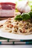Spaghetti carbonara with bacon and basil Stock Photos