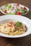 Spaghetti carbonara with bacon. Spaghetti carbonara with bacon, cheese and parsley on white dish Royalty Free Stock Photos