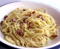 Spaghetti carbonara with Bacon egg and Parmesan in a typical Ita Royalty Free Stock Photo