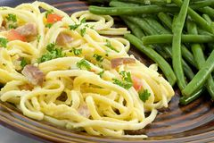 Spaghetti carbonara and beans Royalty Free Stock Photos