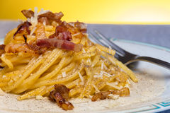Spaghetti Carbonara. Close up of Carbonara Spaghetti. Original Recipe with parmiggiano and pecorino romano stock photo