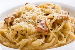 Spaghetti carbonara closeup. Fresh tasty italian spaghetti carbonara closeup with ham Royalty Free Stock Photography