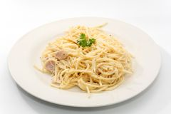 Spaghetti carbonara with cream. On white plate royalty free stock image