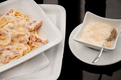 Spaghetti Carbonara with extra cheese. Spaghetti carbonara with bacon and parmesan Royalty Free Stock Photos