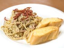 Spaghetti Carbonara. And garlic bread Stock Photo