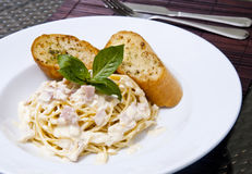 Spaghetti Carbonara with garlic bread food Royalty Free Stock Photography
