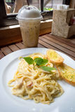 Spaghetti carbonara with garlic breads. And iced coffee Royalty Free Stock Photo