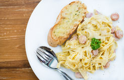 Spaghetti Carbonara with ham and cheese on desk Royalty Free Stock Photos