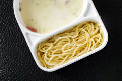 Spaghetti carbonara with ham in the package Royalty Free Stock Photos