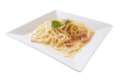 Spaghetti carbonara. With ham on white isolated background Royalty Free Stock Photography