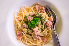 Spaghetti carbonara (with ham) on white plate Royalty Free Stock Images
