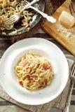 Spaghetti Carbonara - Italian Food. Overhead view of plate of delicious spaghetti Carbonara. Rustic styled royalty free stock image