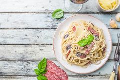 Spaghetti carbonara pasta. Spaghetti carbonara pasta over wooden background, top view Stock Photography