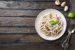 Spaghetti carbonara pasta. Spaghetti carbonara pasta over wooden background, top view Stock Photos