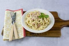 Spaghetti with carbonara sauce stock photo