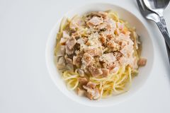 Spaghetti Carbonara sauce, cream cheese and ham is placed on the table. Stock Photography