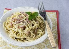 Spaghetti with carbonara sauce stock images