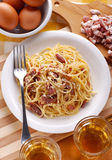 Spaghetti carbonara in a white dish Royalty Free Stock Images