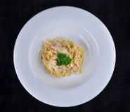 Spaghetti carbonara on white plate. Spaghetti carbonara on a  white plate Royalty Free Stock Photo