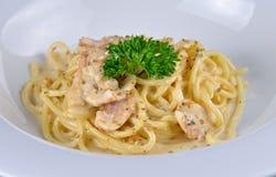 Spaghetti carbonara on white plate. Spaghetti carbonara on a  white plate Royalty Free Stock Photography