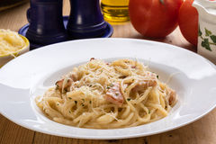 Spaghetti carbonara on wooden table Stock Images