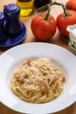 Spaghetti carbonara on wooden table Stock Image