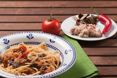 Spaghetti carrettiera. Typical dish of traditional Roman and Italian cuisine made from spaghetti pasta, dried mushrooms, tuna, onion, olive oil Royalty Free Stock Photography
