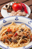 Spaghetti carrettiera. Typical dish of traditional Roman and Italian cuisine made from spaghetti pasta, dried mushrooms, tuna, onion, olive oil Royalty Free Stock Photo