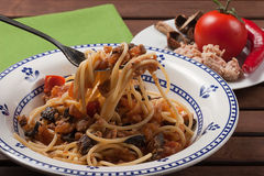 Spaghetti carrettiera. Typical dish of traditional Roman and Italian cuisine made from spaghetti pasta, dried mushrooms, tuna, onion, olive oil Stock Photography