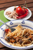 Spaghetti carrettiera. Typical dish of traditional Roman and Italian cuisine made from spaghetti pasta, dried mushrooms, tuna, onion, olive oil Stock Photos