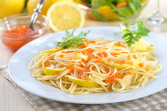 Spaghetti with caviar. Italian spaghetti with lemon sauce and Russian trout caviar Royalty Free Stock Photo