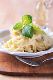 Spaghetti with cheese sauce Stock Image
