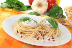 Spaghetti with cheese and spinach sauce Royalty Free Stock Images