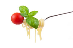 Spaghetti with cherry tomatoes and basil on  fork Stock Images