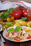 Spaghetti with cherry tomatoes, basil and parmesan Royalty Free Stock Photos