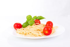 Spaghetti with cherry tomatoes and basil Royalty Free Stock Photos