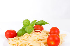 Spaghetti with cherry tomatoes and basil Royalty Free Stock Images