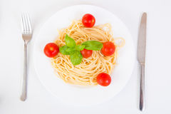 Spaghetti with cherry tomatoes and basil Stock Photo