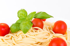 Spaghetti with cherry tomatoes and basil Royalty Free Stock Image